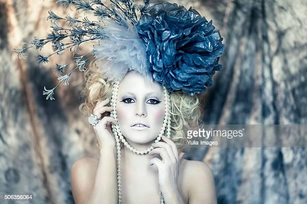 Enchanting woman in pale make up looking at camera