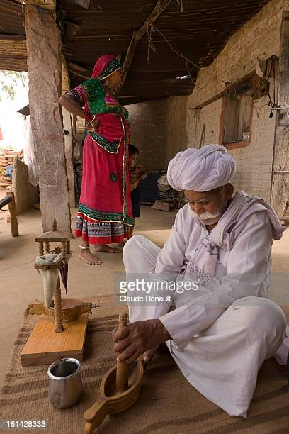 Enchie's husband preparing the ritual Opium ceremonial in a Bishnoi family in a village south of Jodhpur.