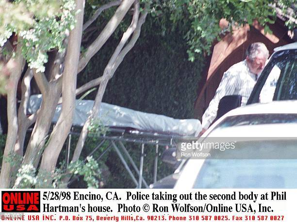 Encino CA Police taking out the second body at Phil Hartman's house
