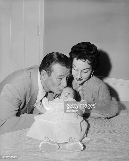 Encino, California: Here is the first formal picture of Aissa Wayne, 20 day old daughter of John Wayne and his wife, Pilar Pallette. The little one...
