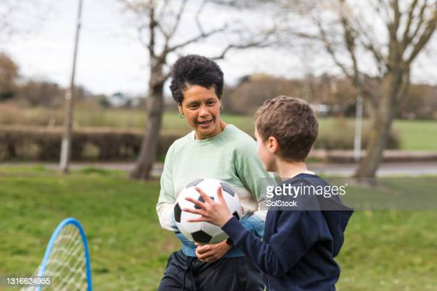encouragement from mum - football stock pictures, royalty-free photos & images