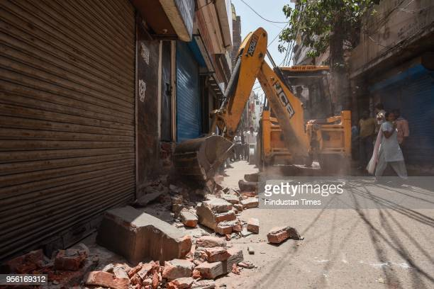 Encroachment removal drive carried out by South Delhi Municipal Corporation at a market in Kotla Mubarakpur Gurudwara Road on May 8 2018 in New Delhi...