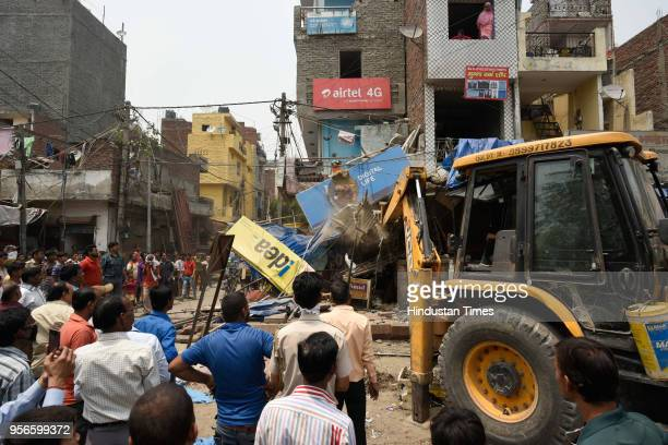 Encroachment removal drive carried out by South Delhi Municipal Corporation at Fateh Singh Marg Govindpuri Kalkaji Extension on May 9 2018 in New...