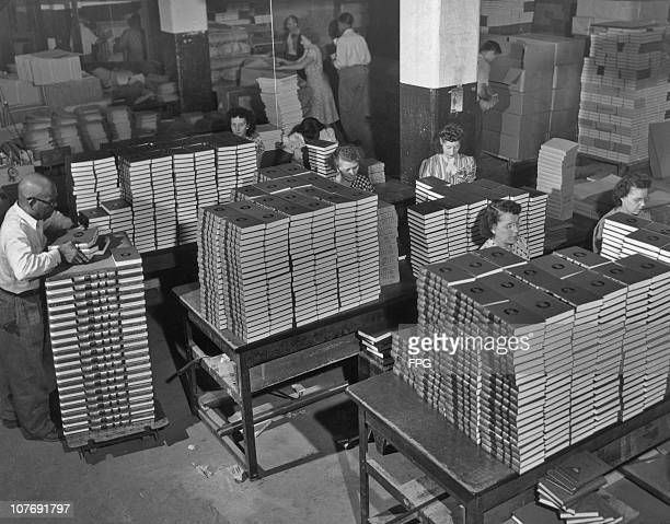 Encyclopedia volumes are checked and piled ready for delivery at the H Wolff Book Manufacturing Co New York City USA November 1948