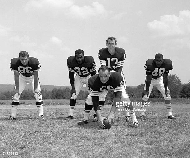 End Gary Collins runningback Jim Brown quarterback Frank Ryan center John Morrow and runningback Ernie Green of the Cleveland Browns pose for a group...