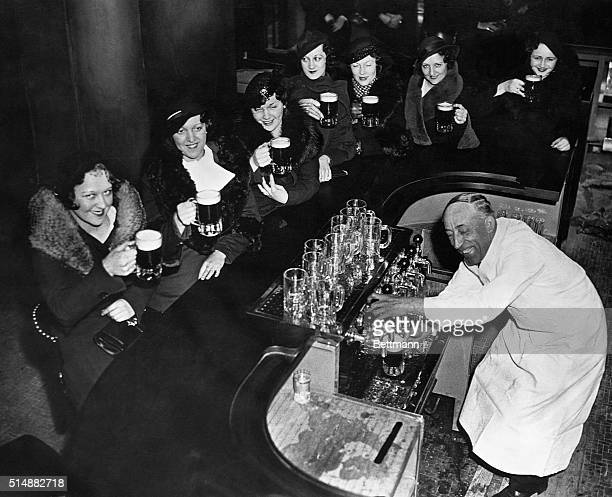 Young girls having their first beer at a public bar Photograph 1933