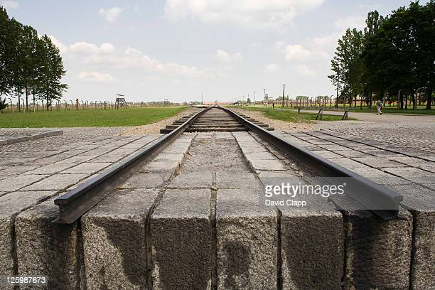 end of railway line where trains would have brought new prisoners into camp at birkenhau, auschwitz concentration camp in poland - birkenau stock pictures, royalty-free photos & images