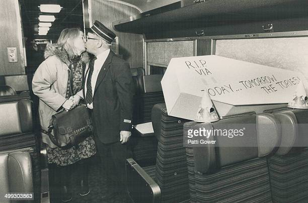 End of the line Friends Barbara Heindrich and VIA Rail conductor Doug Standen kiss goodbye yesterday as she leaves the train at Cavan for the last...