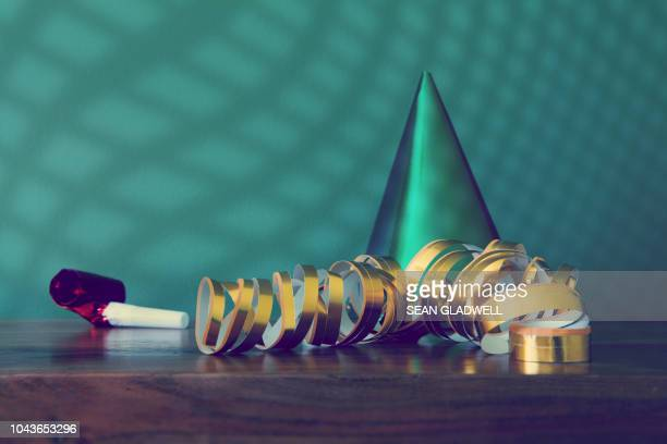 end of the party - party blower stock pictures, royalty-free photos & images