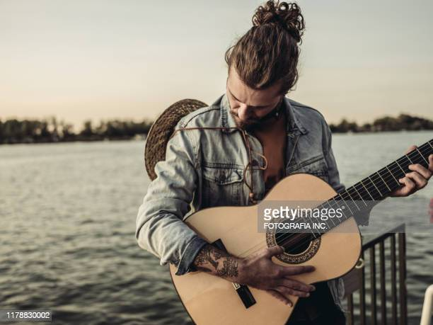 end of the summer - man bun stock pictures, royalty-free photos & images