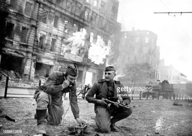 End of the war in Berlin 1945 Soviet soldiers ensure the communication link as fights on Frankfurter Allee are ongoing during the advance of the Red...