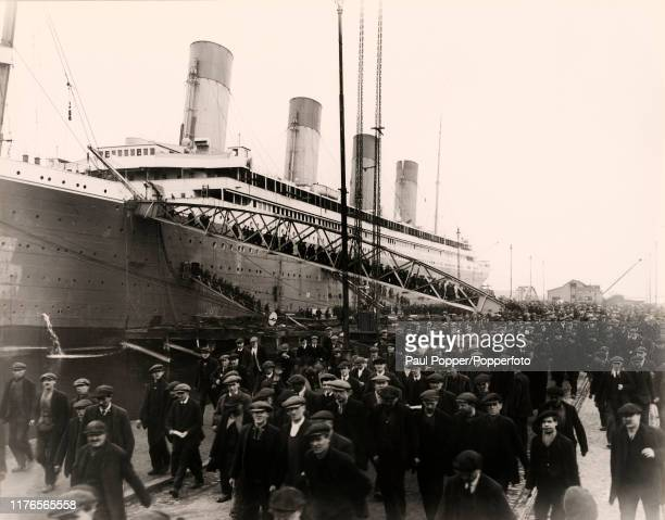 End of the working day on the construction site of the RMS Titanic at the Harland and Wolff shipyard in Belfast Northern Ireland circa 1911