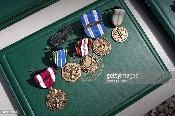 End of tour medals are seen during a ceremony on August 11 2009 in Camp Clark Nader Shah Kot Khost Province AfghanistanThe Human Terrain System...