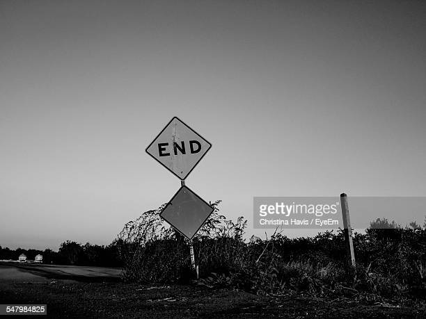 end road sign by road against clear sky - central california stock pictures, royalty-free photos & images