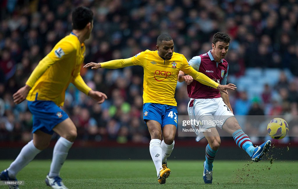 Enda Stevens of Aston Villa is challenged by Jason Puncheon of Southampton during the Barclays Premier League match between Aston Villa and Southampton at Villa Park on January 12, 2013 in Birmingham, England.