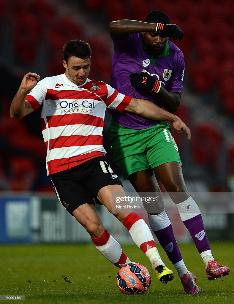 Enda Stevens (L) of Doncaster Rovers challenged by Jay Emmanuel-Thomas of Bristol City during the FA Cup Third Round match between Doncaster Rovers and Bristol City at Keepmoat Stadium on January 3, 2015 in Doncaster, England.