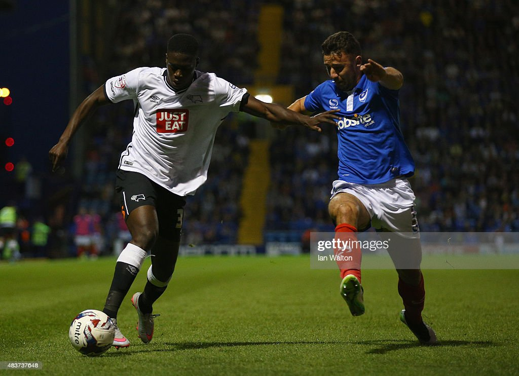 Enda Stevens of Portsmouth tries to tackle Isak Ssewnkambo of Derby County during the Capital One Cup First Round match between Portsmouth v Derby County at Fratton Park on August 12, 2015 in Portsmouth, England.