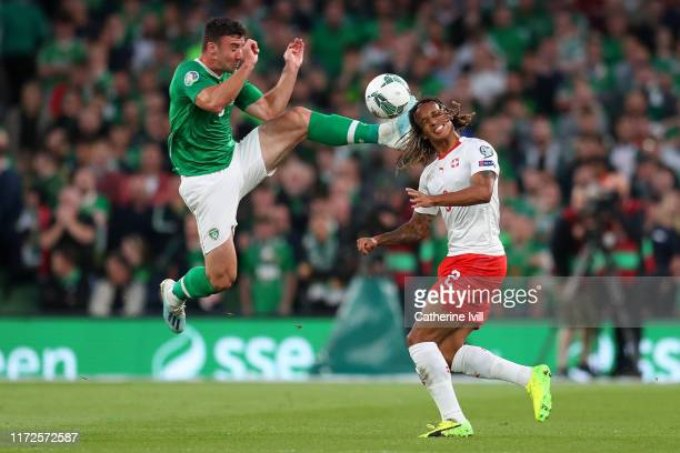 Enda Stevens of Republic of Ireland makes a high challenge on Kevin Mbabu of Switzerland during the UEFA Euro 2020 qualifier between Republic of...