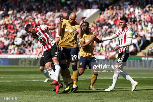 Enda Stevens of Sheffield United heads the ball away from Yohan Benalouane of Nottingham Forest during the Sky Bet Championship fixture between...