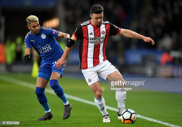 Enda Stevens of Sheffield United holds off Riyad Mahrez of Leicester during The Emirates FA Cup Fifth Round match between Leicester City and...