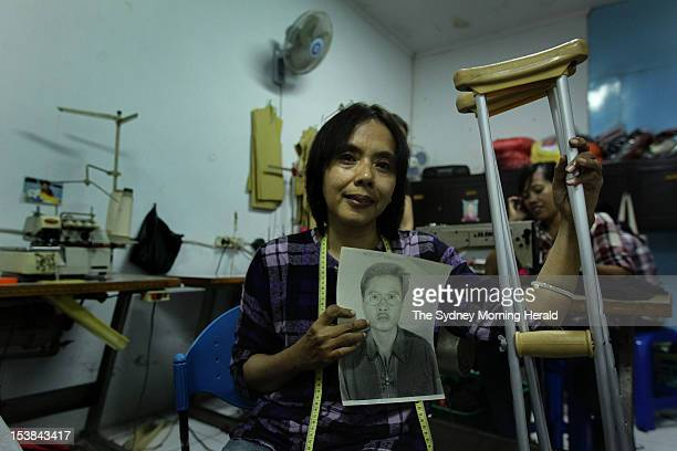 Endang Isnanik holds a photograph of her husband Aris Munandar who died in the 2002 Bali bombings September 25 2012 Endang and four other widows of...