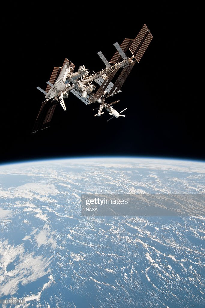 In this handout image provided by the European Space Agency (ESA) and NASA, the International Space Station and the docked space shuttle Endeavour orbit Earth during Endeavour's final sortie on May 23, 2011, in Space. Italian astronaut Paolo Nespoli captured the first-ever images of an orbiter docked to the International Space Station from the viewpoint of a departing vessel as he returned to Earth in a Soyuz capsule.
