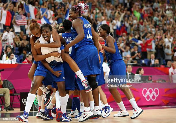 Endene Miyem of France celebrates with Sandrine Gruda on her back after defeating Russia 81-64 in the Women's Basketball semifinal on Day 13 of the...