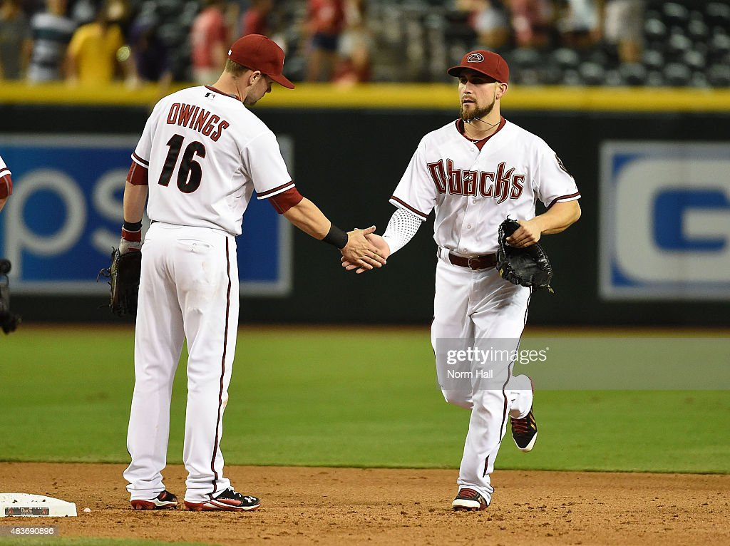 Ender Inciarte #5 and Chris Owings #16 of the Arizona Diamondbacks celebrate a 13-1 win against the Philadelphia Phillies at Chase Field on August 11, 2015 in Phoenix, Arizona.