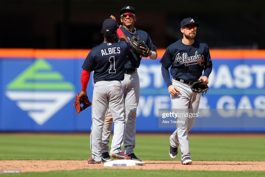 Ender Inciarte #11 and Ronald Acuna Jr. #13 celebrate with Ozzie Albies #1 of the Atlanta Braves after defeating the New York Mets 11-0 at Citi Field on Thursday, May 3, 2018 in the Queens borough of New York City.