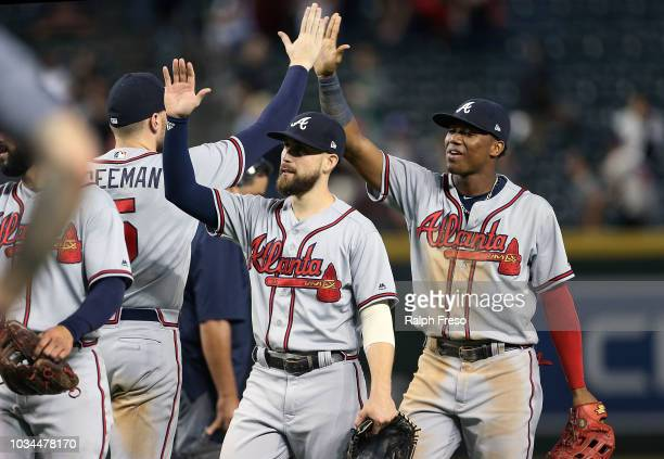 Ender Inciarte and Ronald Acuna Jr #13 of the Atlanta Braves are congratulated by teammates after a 95 victory against the Arizona Diamondbacks...
