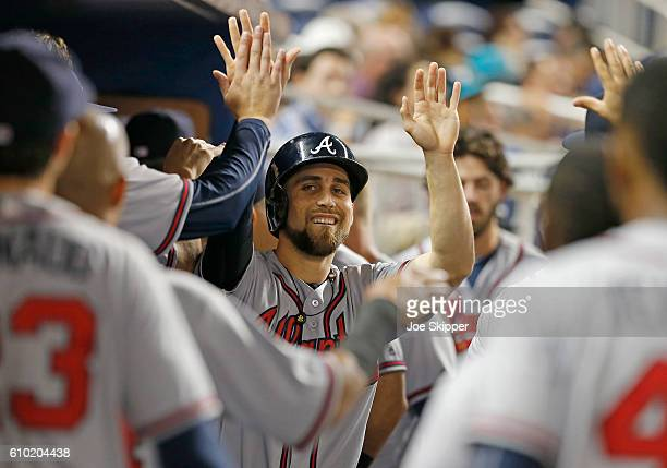 Ender Inciarte center of the Atlanta Braves celebrates with teammates after he scored in the first inning against the Miami Marlins at Marlins Park...