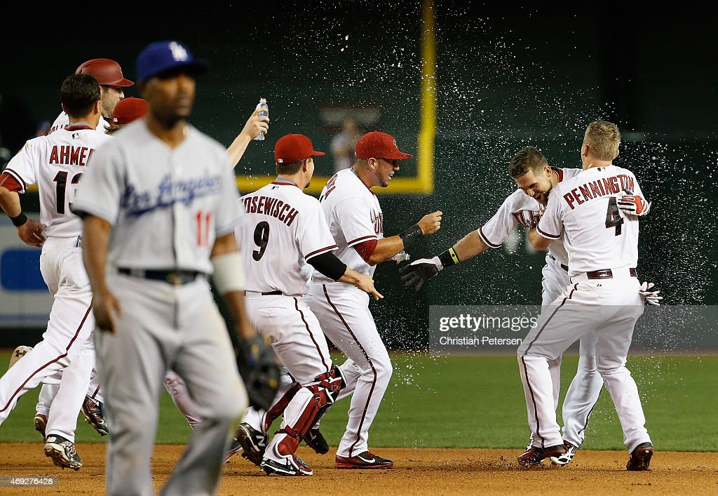 Ender Inciarte #5 of the Arizona Diamondbacks is congratulated by David Peralta #6 and Cliff Pennington #4 after Inciarte hit a walk off RBI single against the Los Angeles Dodgers during the 10th inning of the MLB game at Chase Field on April 10, 2015 in Phoenix, Arizona. The Diamondbacks defeated the Dodgers 4-3 in 10 innings.