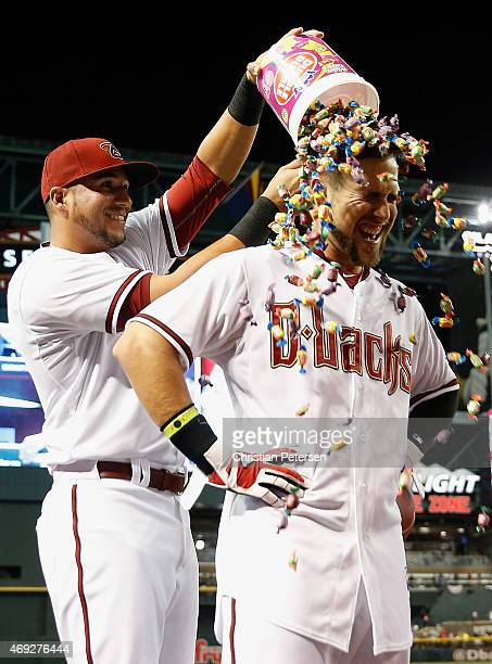 Ender Inciarte of the Arizona Diamondbacks is congratulated by David Peralta with a bubble gum dunk after Inciarte hit a walk off RBI single against...