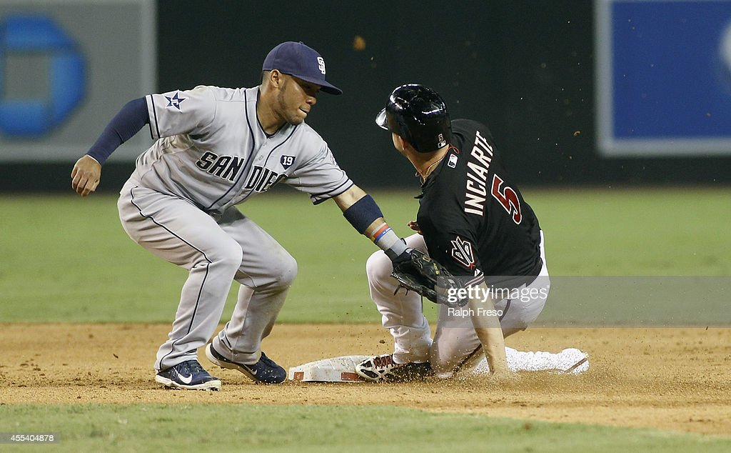 Ender Inciarte #5 of the Arizona Diamondbacks slides in ahead of the tag by Alexi Amarista #5 of the San Diego Padres as he steals second base during the sixth inning of a MLB game at Chase Field on September 13, 2014 in Phoenix, Arizona.