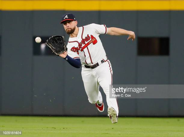 Ender Inciarte of the Atlanta Braves attempts to make a play on a twoRBI single hit by Joey Wendle of the Tampa Bay Rays in the first inning at...