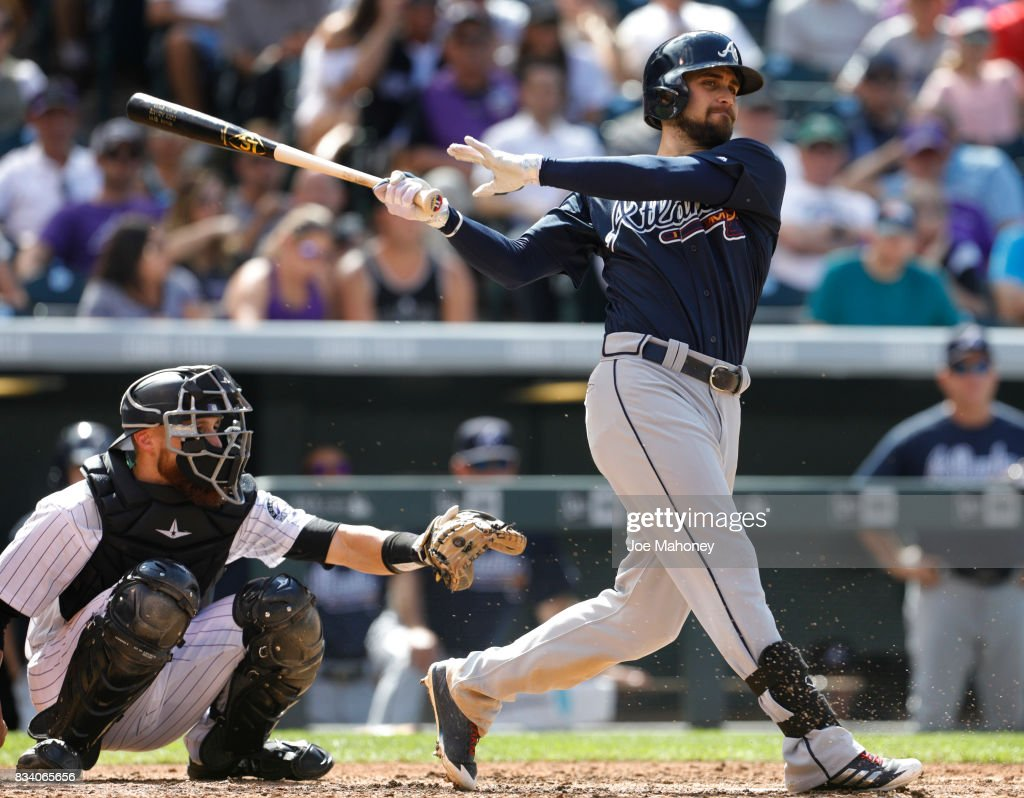 Ender Inciarte #11 of the Atlanta Braves bats against the Colorado Rockies in the seventh inning at Coors Field on August 17, 2017 in Denver, Colorado. Ryan Hanigan #30 of the Colorado Rockies catches.