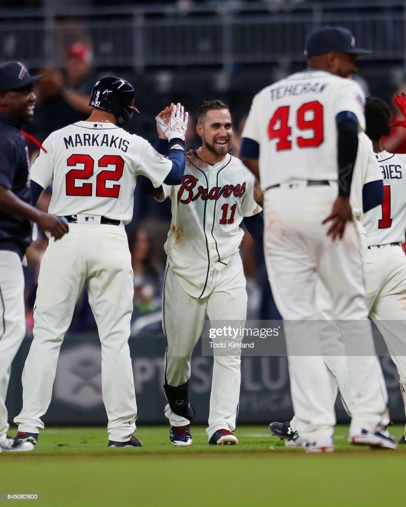 Ender Inciarte #11 of the Atlanta Braves celebrates the victory with Nick Markakis #22 at the conclusion of an MLB game against the Miami Marlins at SunTrust Park on September 9, 2017 in Atlanta, Georgia. The Braves won 6-5.