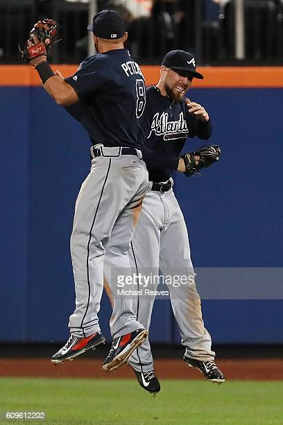 Ender Inciarte of the Atlanta Braves celebrates with Jace Peterson after he robbed a home run to end the game against the New York Mets at Citi Field...