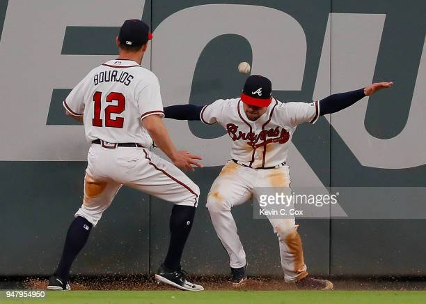 Ender Inciarte of the Atlanta Braves fails to catch this twoRBI double hit by Maikel Franco of the Philadelphia Phillies in the 10th inning at...