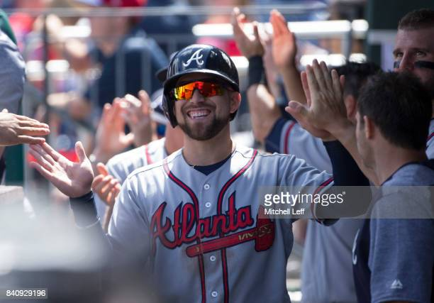 Ender Inciarte of the Atlanta Braves high fives his teammates after scoring a run in the top of the first inning against the Philadelphia Phillies in...