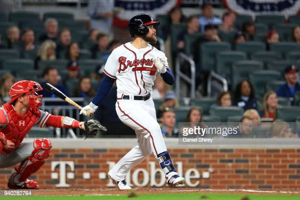 Ender Inciarte of the Atlanta Braves hits a sacrifice fly to drive in Ryan Flaherty during the third inning against the Philadelphia Phillies at...
