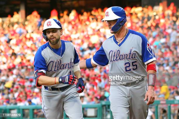 Ender Inciarte of the Atlanta Braves is congratulated by Tyler Flowers after he hit a two-run home run against the Philadelphia Phillies during the...