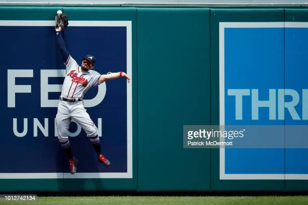 Ender Inciarte of the Atlanta Braves is unable to catch a single hit by Juan Soto of the Washington Nationals in the third inning at Nationals Park...