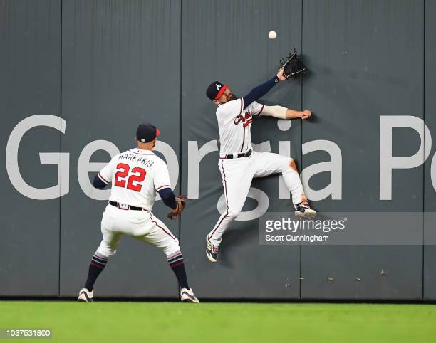 Ender Inciarte of the Atlanta Braves is unable to make a catch during the ninth inning against the Philadelphia Phillies at SunTrust Park on...