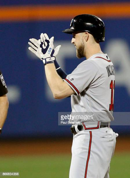 Ender Inciarte of the Atlanta Braves looks towards his dugout and celebrates at second base after hitting a double for his 200th hit of the season in...