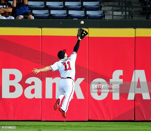 Ender Inciarte of the Atlanta Braves makes a leaping attempt of a fourth inning double by Cameron Rupp of the Philadelphia Phillies at Turner Field...