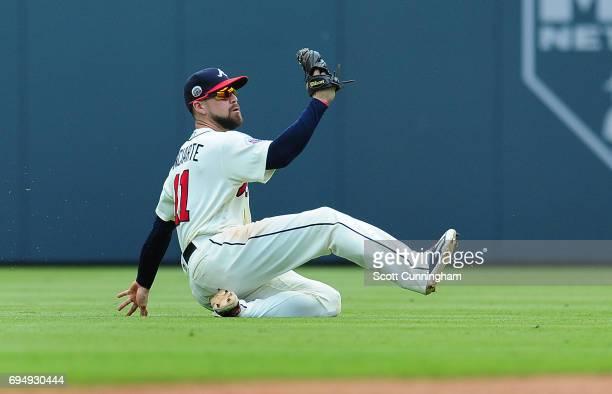 Ender Inciarte of the Atlanta Braves makes a ninth inning sliding catch against the New York Mets at SunTrust Park on June 11 2017 in Atlanta Georgia