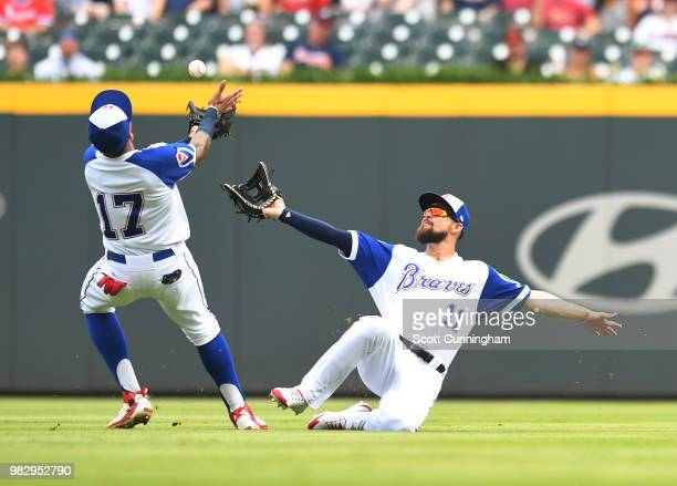 Ender Inciarte of the Atlanta Braves makes a sliding catch as Johan Camargo closes in during the first inning against the Baltimore Orioles at...