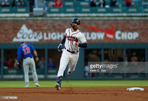 Ender Inciarte of the Atlanta Braves rounds second base after hitting a solo homer to lead off the first inning against the Chicago Cubs on April 01,...