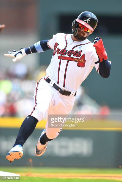 Nick Markakis of the Atlanta Braves hits an eighth inning double against the San Diego Padres at SunTrust Field on June 17 2018 in Atlanta Georgia
